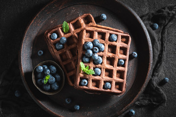 Sweet waffles with dark chocolate and fresh berries