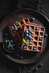 Yummy waffles with dark chocolate and fresh berries