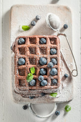 Delicious waffles with dark chocolate and fresh blueberries