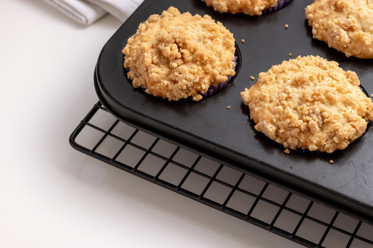 Blueberry Apple Oats streusel Muffins on cooling rack. Selective focus. Copy space for text. Healthy breakfast concept