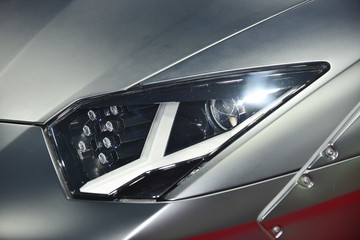 Wall Mural - Close up detail on one of the LED headlights modern super car