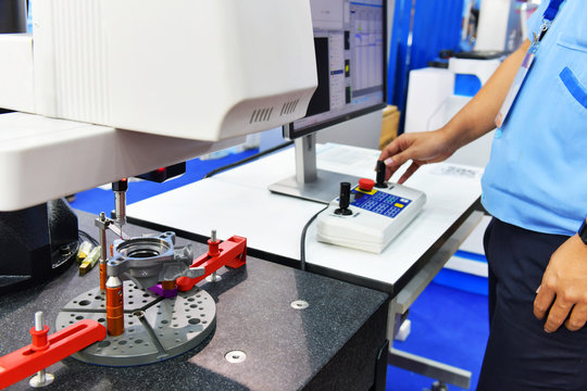 Close up automatic coordinate measurement machine (CMM) for inspection high precision part during working