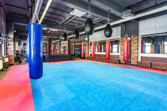 GRODNO, BELARUS - APRIL 2019: Hall of martial arts with fighting ring and punching bags in the modern Fight club