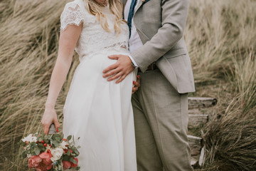pregnant bride and groom