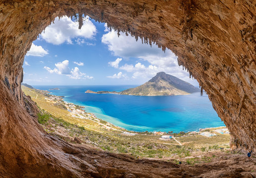 """The famous """"Grande Grotta"""", one of the most popular climbing fields of Kalymnos island, Greece. In the background, Telendos island."""