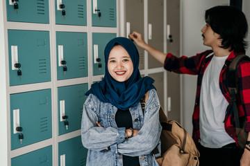 muslim asian student friend in locker room of school