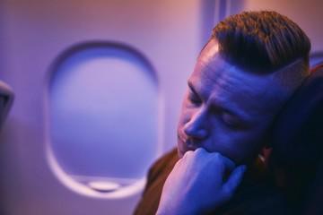 Passenger sleeping during night flight