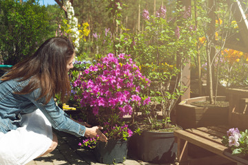 Woman chooses flower pots at garden plant nursery store