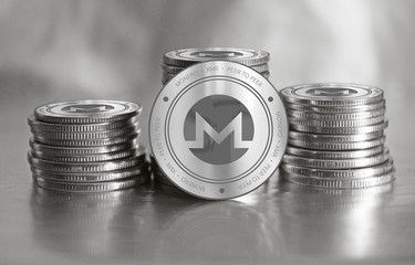 Monero (XMR) digital crypto currency. Stack of silver coins. Cyber money.