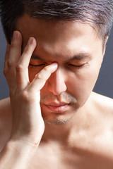 portrait of unhappy asian man, close up