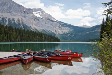 Foto op Canvas Canada red canoes on a Emerald lake, Yoho National Park, British Columbia, Canada
