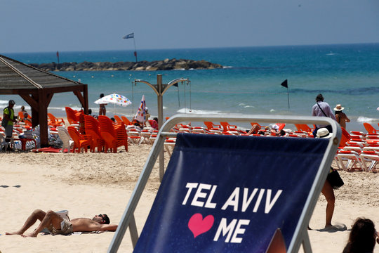 A large beach chair bearing part of the 2019 Eurovision Song Contest logo is seen on a beach as the opening ceremony of the contest begins tonight, in Tel Aviv, Israel