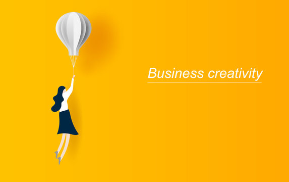 Business creativity vector concept idea with business woman flying with balloon. Symbol of innovation. Graphic design paper cut and art style for card, Poster.yellow. Vector illustration. EPS10