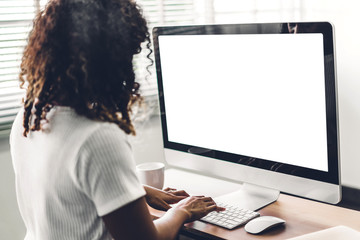 African american black woman using computer with white mockup blank screens in modern work loft