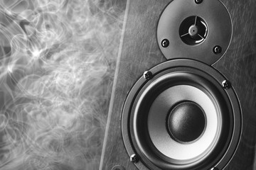 Speaker system on the background of smoke.