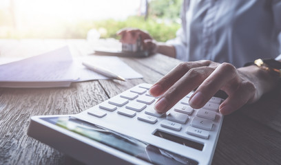 Business concept, Businessman using calculator to calculate loan plan