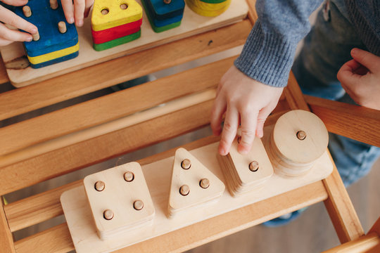 child playing with wooden educational toys