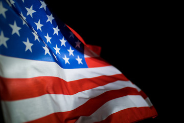 American flag on black background.