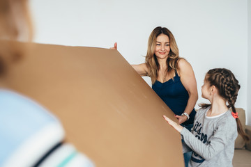 Woman and her daughters moving in new home
