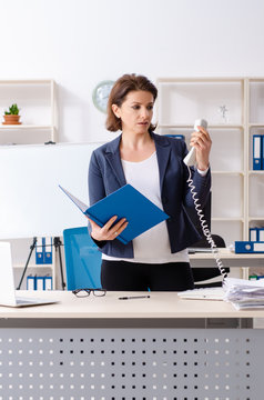 Experienced female employee working in the office