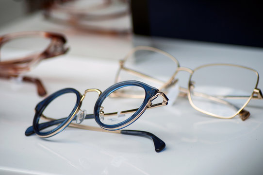 closeup of eyeglasses collection in store showroom