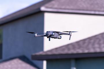 Camera drone spying on neighborhood house