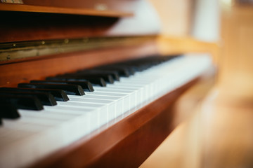 Rustic piano: close up picture of classical piano keys, selective focus