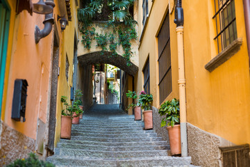 Old picturesque street with amazing view in beautiful Bellagio, Como lake, Italy