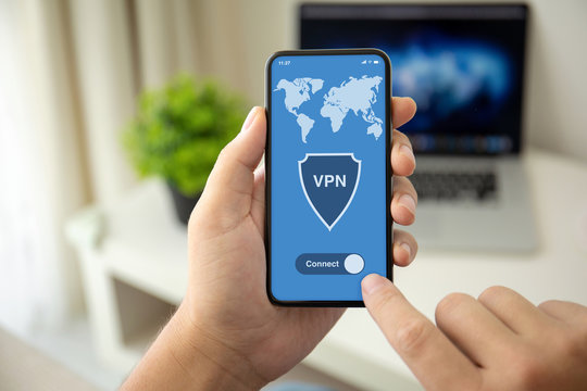 man hands holding phone with app vpn on the screen