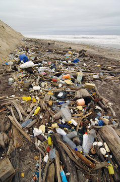 garbages, plastic, and wastes on the beach after winter storms. Atlantic west coast of france. Every day, waste accumulates on the beach of Atlantic west coast