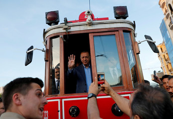 Turkish President Erdogan rides on a vintage tram at Taksim Square in central Istanbul