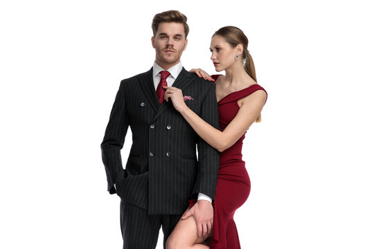 Handsome guy dressed getting his tie fixed by his girlfriend