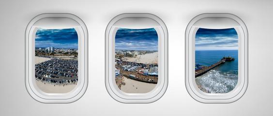 Santa Monica as seen through three aircraft windows. Holiday and travel concept Wall mural