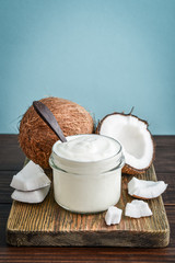 Coconut cream in a glass jar with fresh coconut