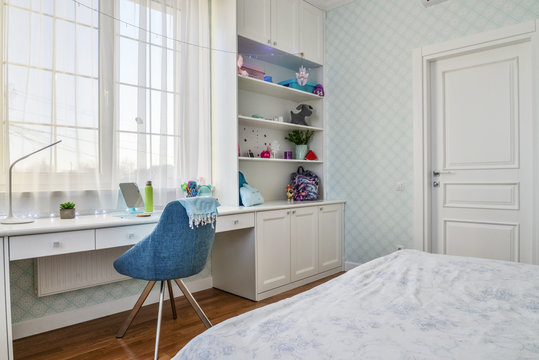 Interior of a teenage girl room in blue and white colors