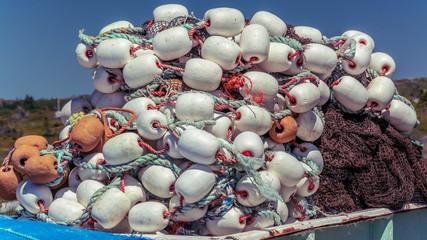 Fishing Buoys piled on a wharf in Nova Scotia