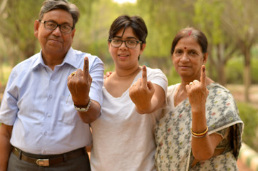 Printed kitchen splashbacks Monkey Happy Family portrait - Senior Retired parents and their daughter showing the inked finger after voting in Indian elections in an outdoor park. Celebrating world's largest democratic elections concept