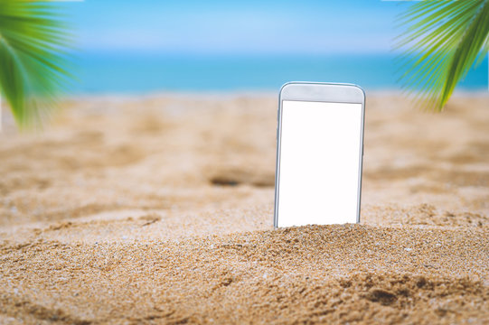 smartphone in the sand on a beach in the summer
