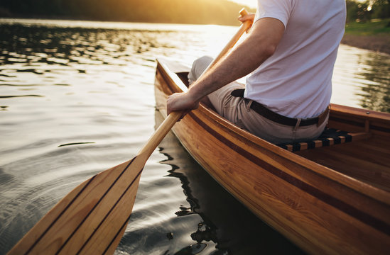 Close up of canoeist with wooden canoe paddle