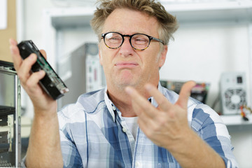 engineer fixing broken computer hard drive