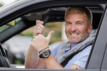 man showing the keys to his new car