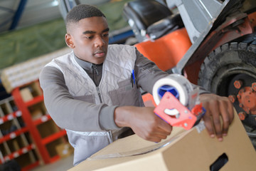 agricultural worker packaging goods for the delivery