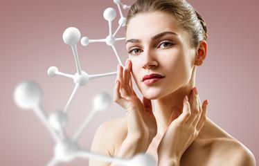 Beautiful woman near big white molecule chain.