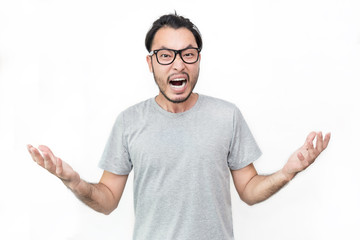 Portrait of angry pensive mad crazy asian nerd man screaming out. Closeup Young asian nerdy man isolated on white background. Stress burnout office syndrome over load office male concept