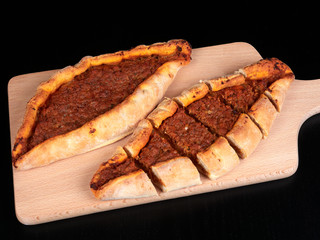Traditional Turkish Cuisine baked pide with beef and onions