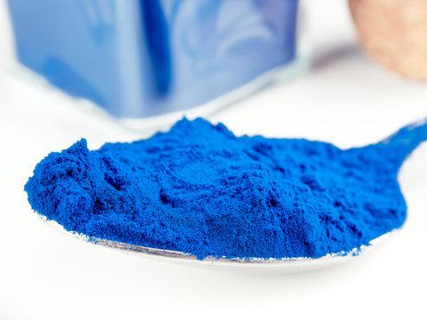 Blue Spirulina powder, isolated on white
