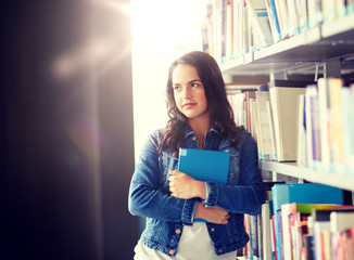 education, high school, university, learning and people concept - student girl with book at library