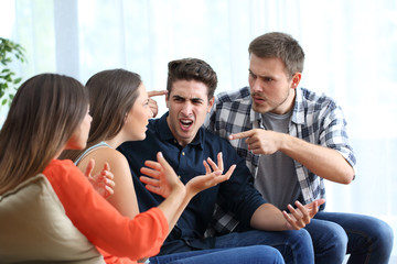 Four angry friends arguing at home