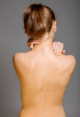 Back of nude woman with seeing spine. Medical or body care concept.