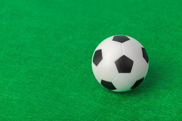 Soccer ball on football field